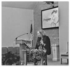 Picture of Pastor Sara preaching